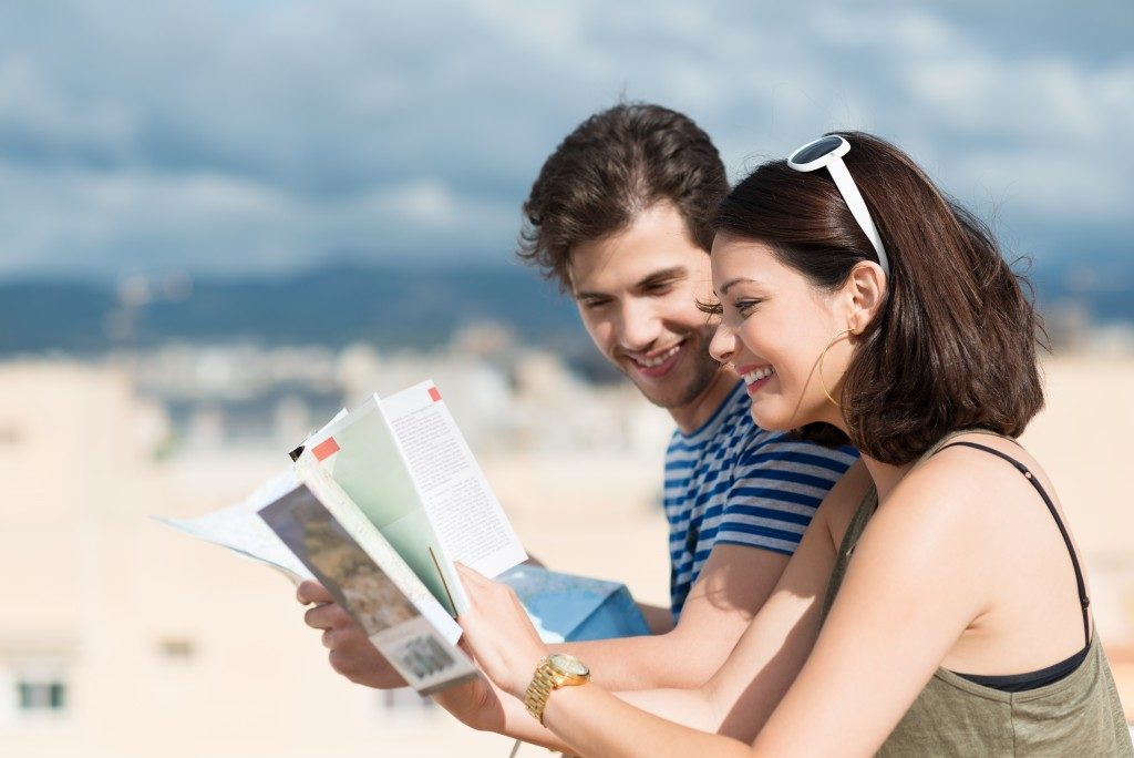 traveler couple looking at a map