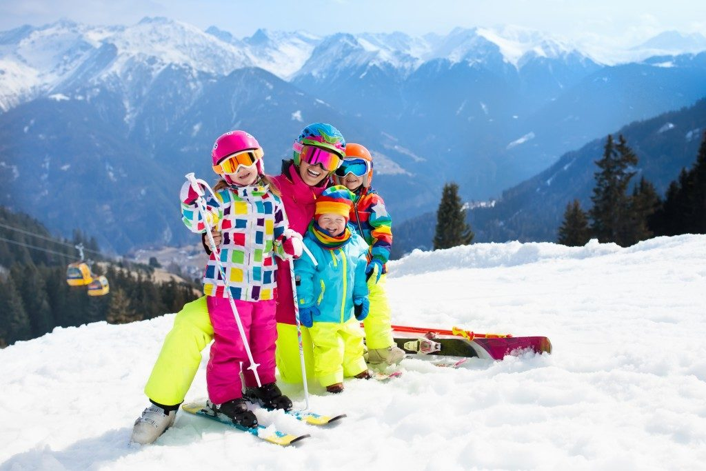 family skiing in the swiss alps