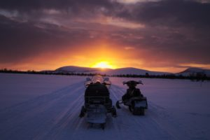 Snowmobile in the sunset