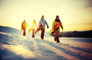 a group of people snowboarding